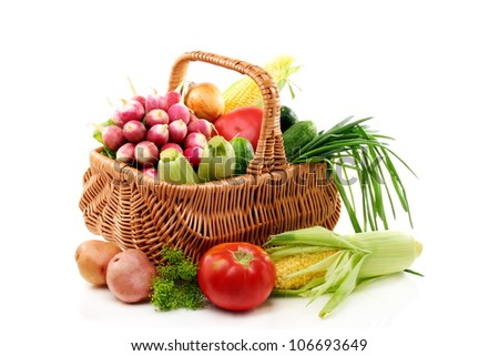 Vegetables in basket on a white background.