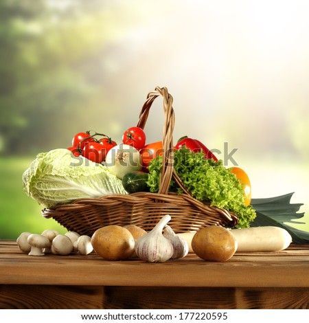 vegetables in basket with garden background  - stock photo