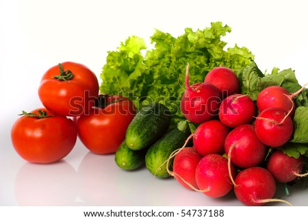 Vegetables in kitchen for salad, isolated on white