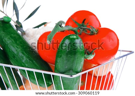 vegetables in metal store basket on white background - stock photo
