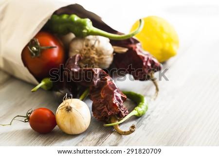 Vegetables in paper bag - stock photo