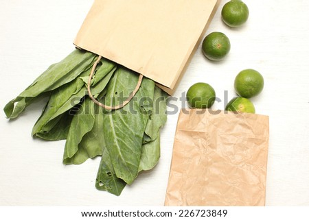 vegetables in paper grocery bag isolated over white - stock photo