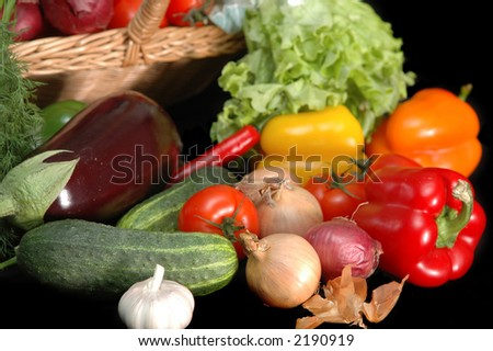 vegetables in the basket on black background