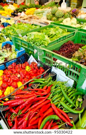Vegetables market with chillies, red peppers and lettuce - stock photo