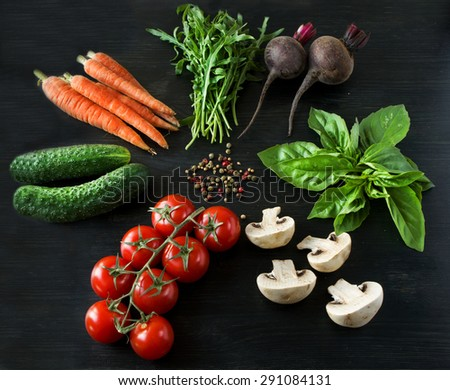 Vegetables on a black wooden background