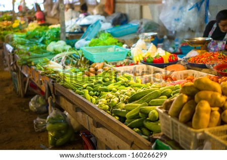 Vegetables on city market in asia - stock photo