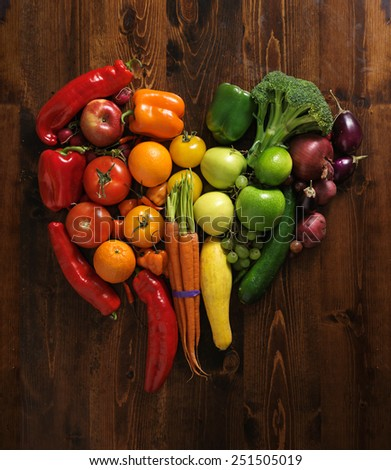 vegetables on cutting board shaped like heart - stock photo