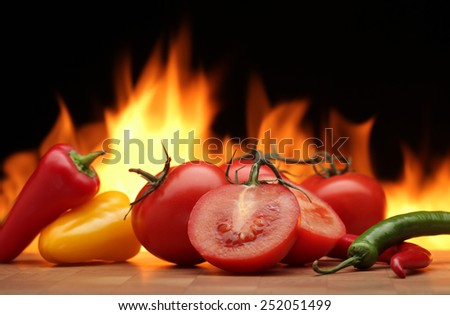 Vegetables  on  fire  background - stock photo