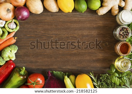 Vegetables on old wooden background overhead close up shoot - stock photo