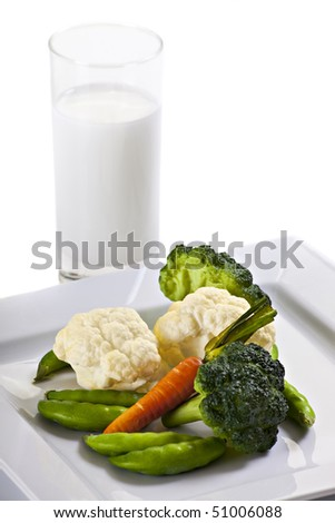 Vegetables On Plate With Glass Of Milk And Napkin - stock photo