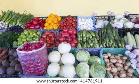 Vegetables on the counter: cabbage, potatoes, beets, zucchini, garlic, onions, tomatoes, cucumbers, radishes, parsley, basil, dill, parsley, pepper, green, yellow, carrot, chili, ginger  - stock photo