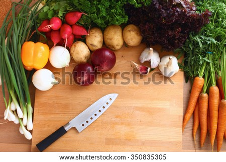 Vegetables on the desk in a kitchen - stock photo