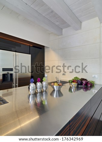vegetables on the steel worktop near to the sink  in a modern kitchen - stock photo