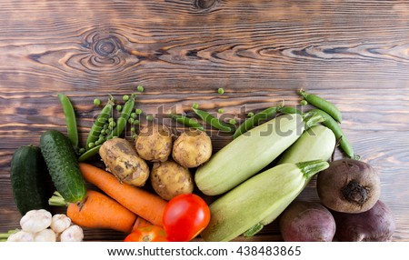 vegetables on the wooden background.