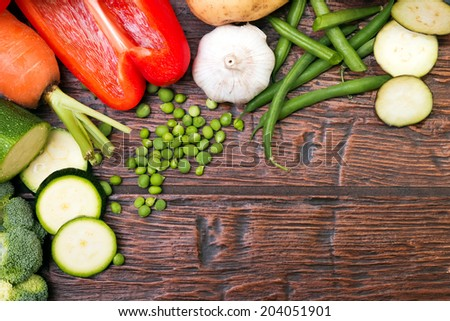 Vegetables on the wooden table, up view