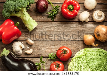 Vegetables on vintage wood background - autumn harvest. Rural still life from above with free text space. - stock photo