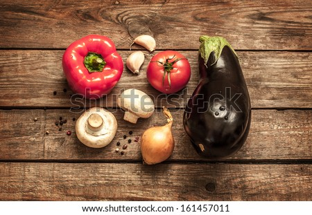 Vegetables on vintage wood background - autumn harvest, soup ingredients. Rural still life from above. - stock photo