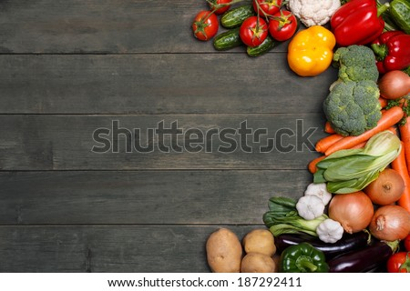 Vegetables on wood background with space for text. Organic food. - stock photo