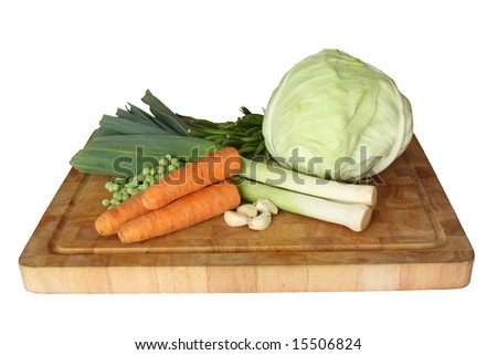 Vegetables over cutting table isolated on white - stock photo