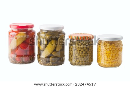Vegetables  preserved in jars isolated on white background