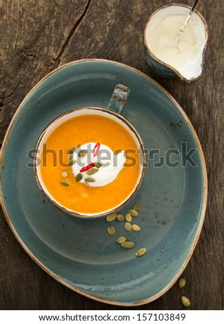 Vegetables (pumpkin, carrot) cream soup. - stock photo