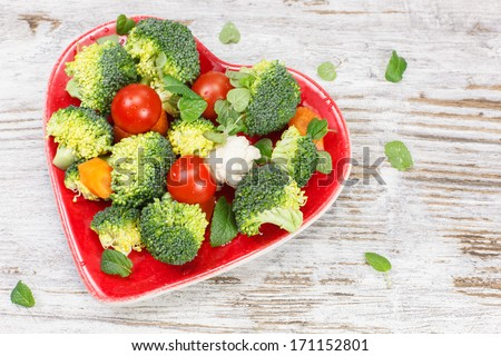Vegetables. Raw vegetable in heart shaped plate. Diet concept. Macrobiotic.  - stock photo