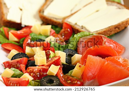 Vegetables salad in a plate fish - stock photo