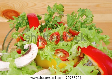 vegetables salad on wooden table - stock photo