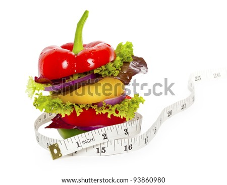 Vegetables sandwich with tape measure around it. Isolated on White
