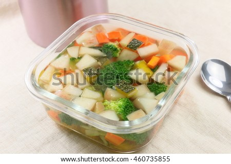 Vegetables soup with broccoli, cucumber, carrot and pumpkin in glass pot