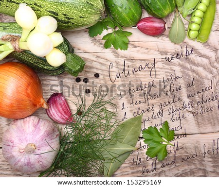 Vegetables, spices and cooking recipe drawing on wooden background - stock photo