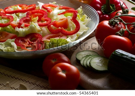 Vegetables stacked on table, still life, salad preparation
