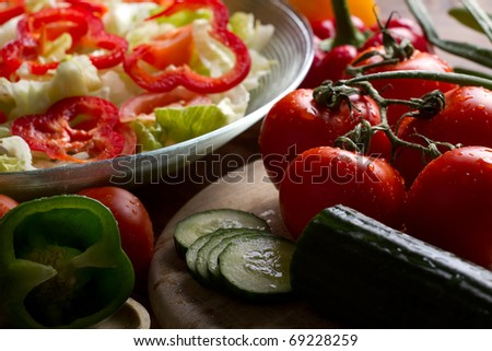 Vegetables stacked on table, still life, salad preparation - stock photo