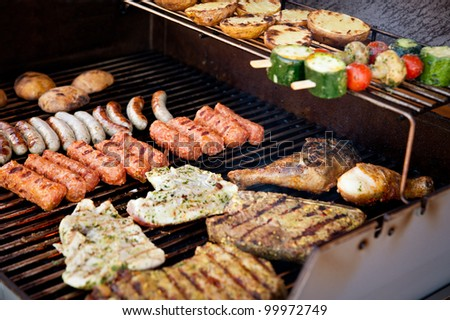 Vegetables, steak and other meat on a BBQ - stock photo