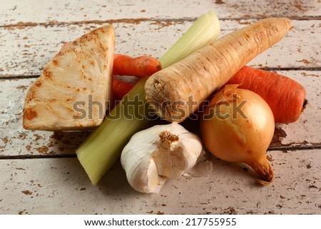 Vegetables to make broth: celery, carrot, parsley root, garlic, onion, leek. - stock photo