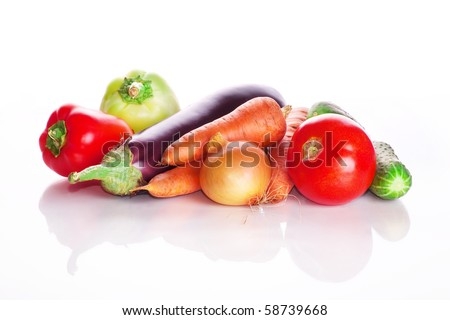Vegetables: tomatoes, carrots, cucumbers, an eggplant, onion on a white background - stock photo