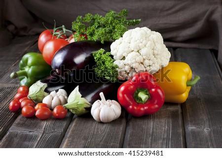 Vegetables: tomatoes,eggplant, peppers,  cauliflower, parsley, basil - stock photo