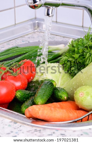 vegetables under running water and drops vertical - stock photo