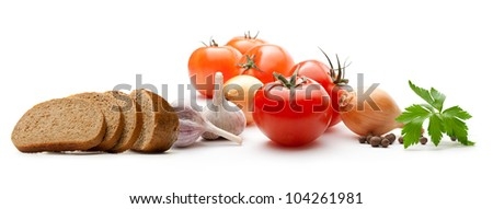 Vegetables with bread on white - stock photo