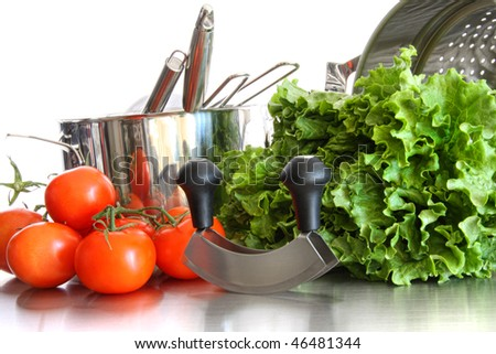 Vegetables with kitchen pots and utensils on white background - stock photo