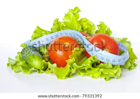 Vegetables with measuring tape on the white background