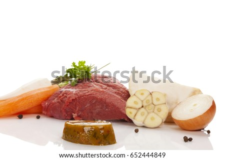 Vegetables with meat isolated on white background. Culinary broth cooking. Bouillon cube.