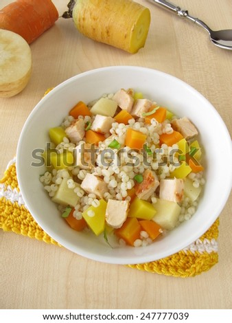 Vegetables with pearl barley and chicken - stock photo