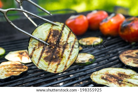 Vegetarian barbecue with tomato, eggplant, grilled on grill - stock photo