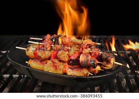 Vegetarian BBQ. Vegetable Mixed Shish Kebabs On Hot Flaming Charcoal Grill, Close Up. Concept For BBQ Backyard Party, Picnic Or Cookout Food - stock photo