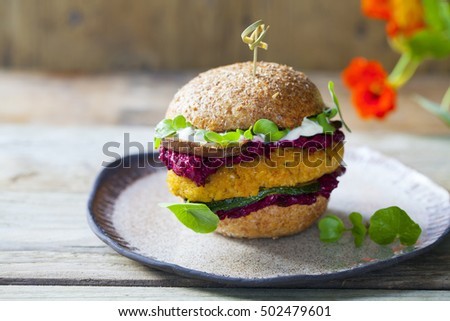 Vegetarian butternut squash burger with beetroot and mushroom