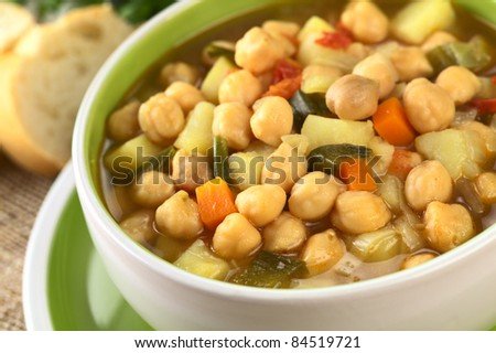 Vegetarian chickpea soup with carrots, potatoes, onions and leek (Selective Focus, Focus one third into the bowl) - stock photo