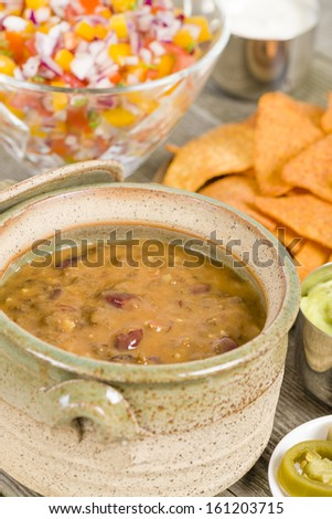 Vegetarian Chili - Chili made with soy protein and beans served with tortilla chips, pico de gallo, jalapenos, guacamole and sour cream.