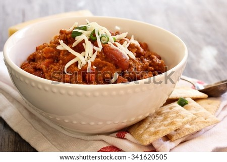 Vegetarian chili with beans on white bowl, selective focus