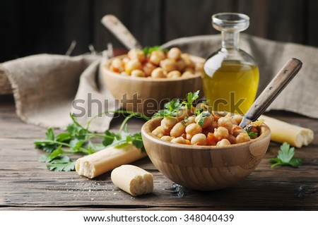 Vegetarian cooked chickpea with tomato and parsley, selective focus - stock photo